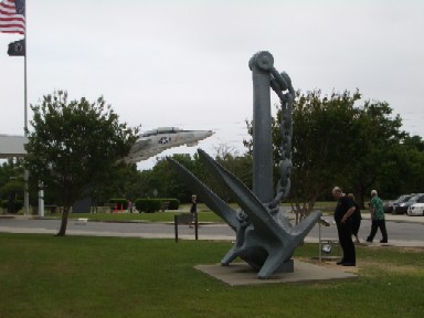 Mike examines the anchor in front of the museum